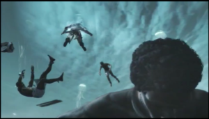 Screenshot of a scene from Assassin's Creed Freedom's Cry depicting the digital bodies of drowned enslaved Africans floating in water